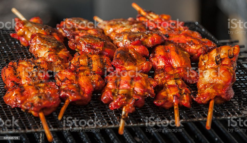 grilled asian chicken on a stick at fest stock photo