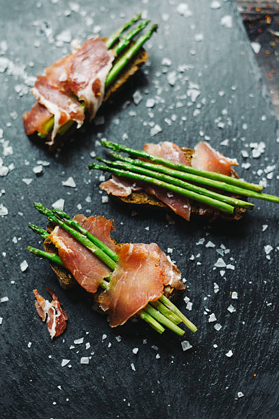 Grilled asparagus and ham tapas stock photo