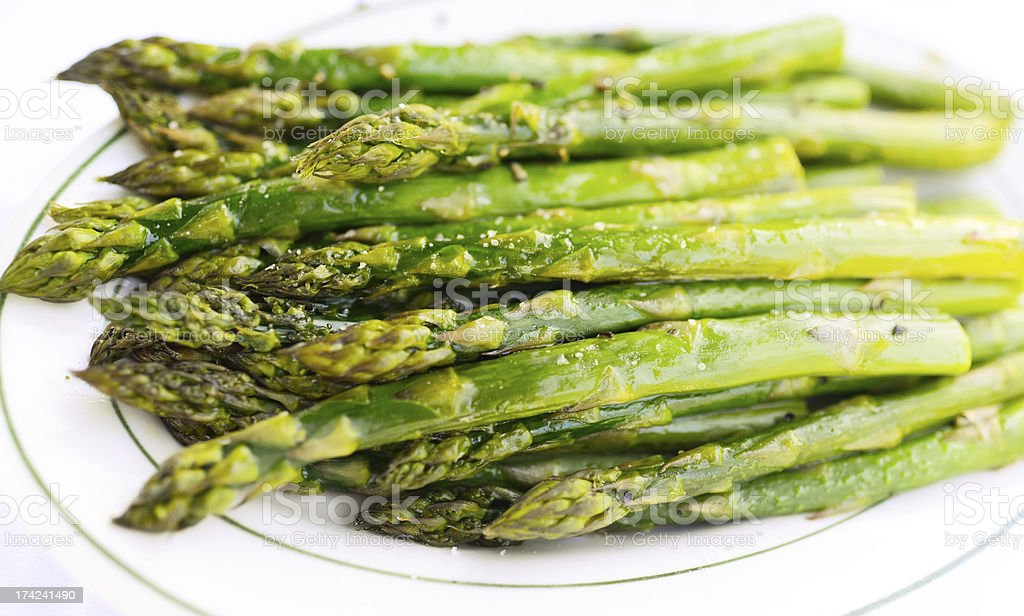 Grilled Asparagus on a plate royalty-free stock photo
