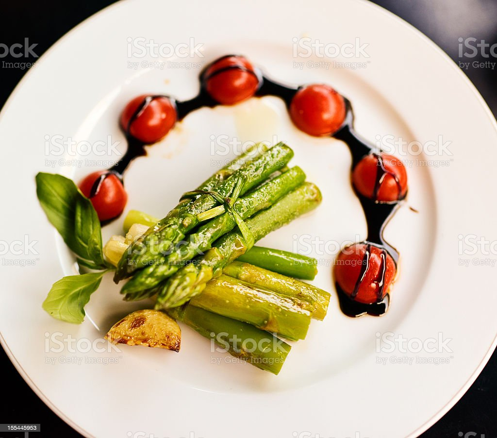 Grilled Asparagus with cherry tomatoes and garlic royalty-free stock photo