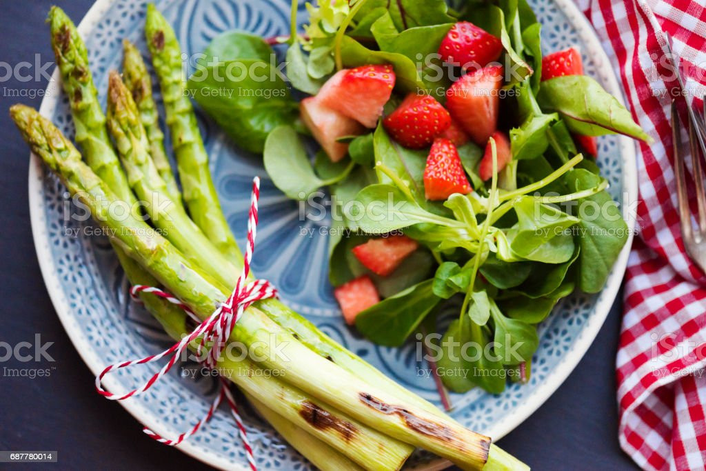 Grilled Asparagus with Strawberries stock photo