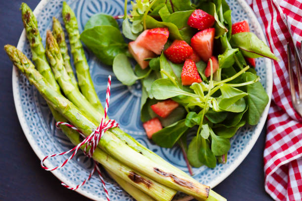 grilled asparagus with strawberries - food styling stock photos and pictures