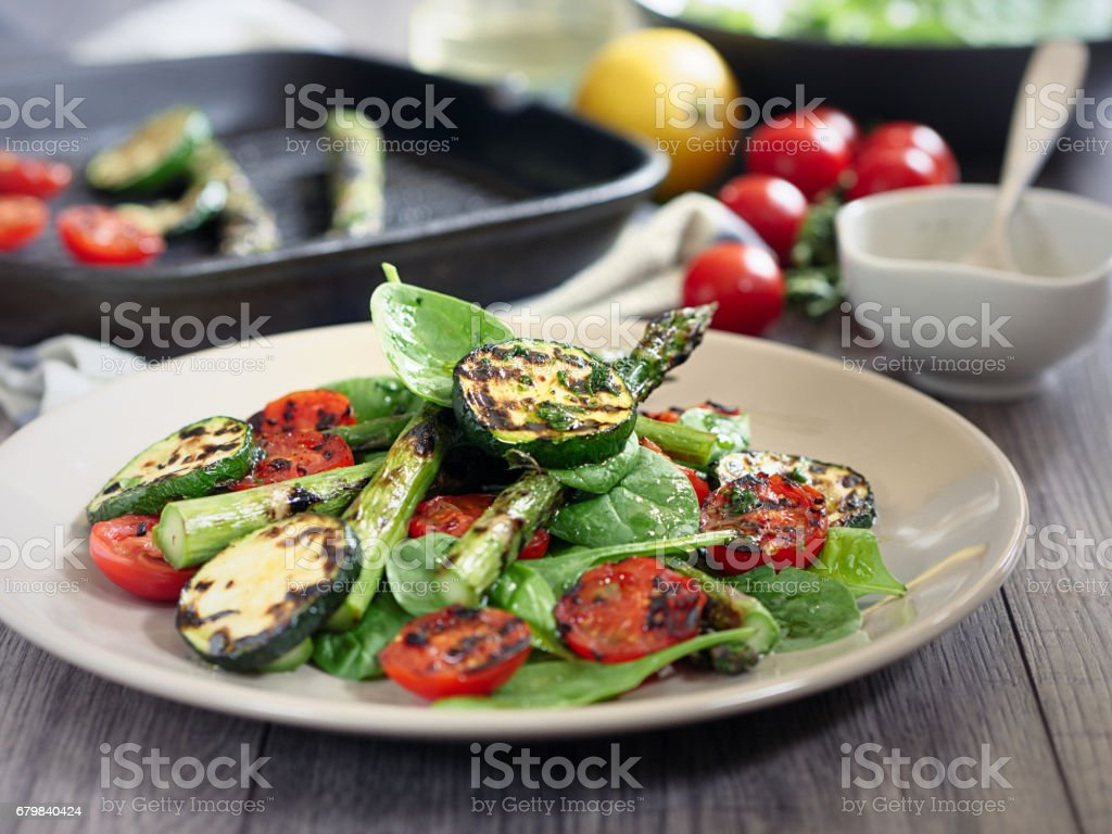 grilled asparagus,courgette and cherry tomatoes salad stock photo