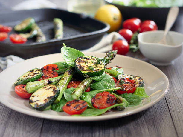 grilled asparagus,courgette and cherry tomatoes salad - grilled vegetables stock photos and pictures