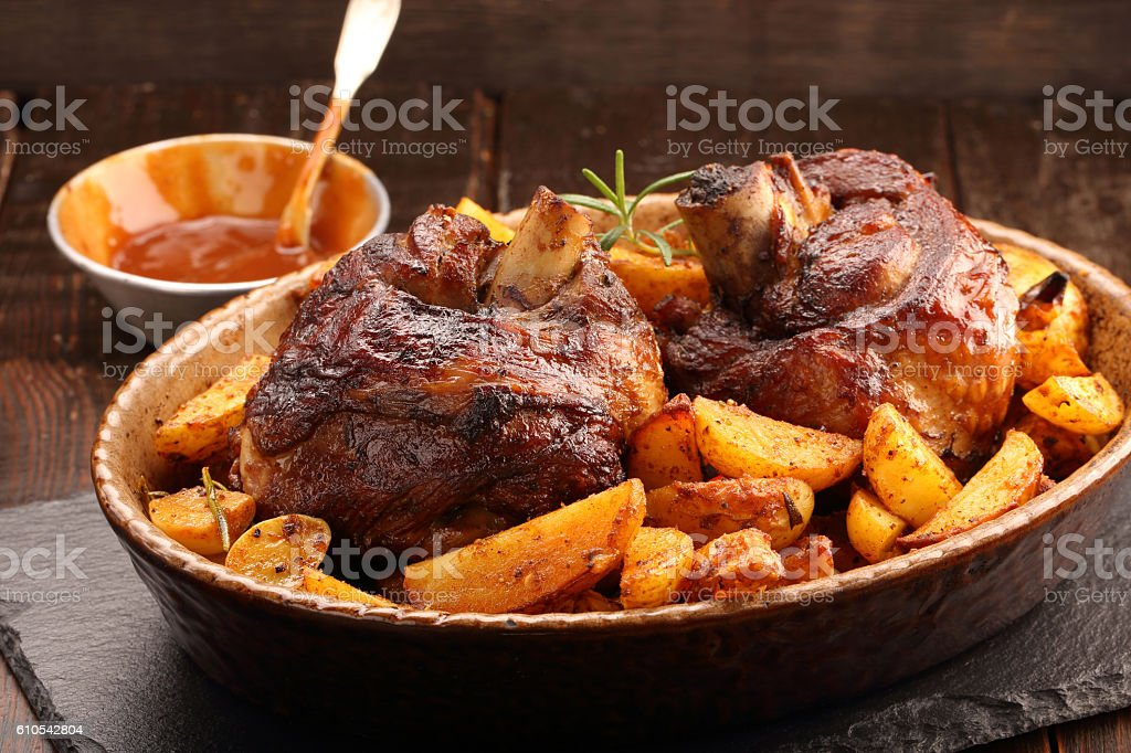 Grilled barbecue meat with baked potato and dip stock photo