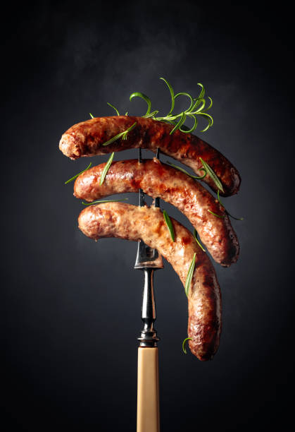 Grilled Bavarian sausages with rosemary. stock photo