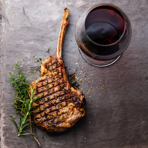 Grilled beef barbecue Veal rib Steak on bone and red wine stock photo
