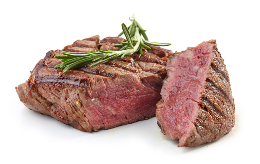 grilled beef fillet steak meat with rosemary isolated on white background