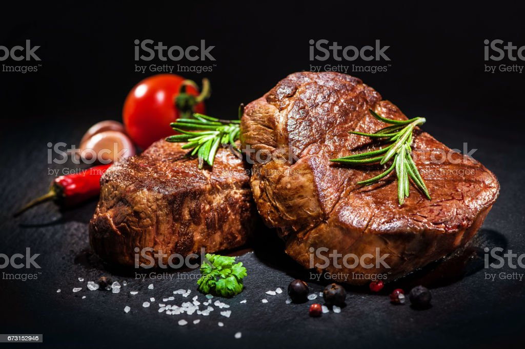Grilled beef fillet steaks with spices stock photo
