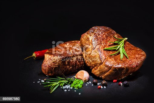 istock Grilled beef fillet steaks with spices 695987580