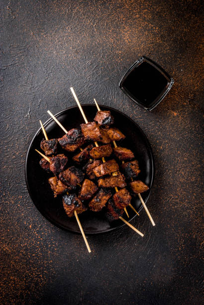 Grilled beef liver on skewers stock photo