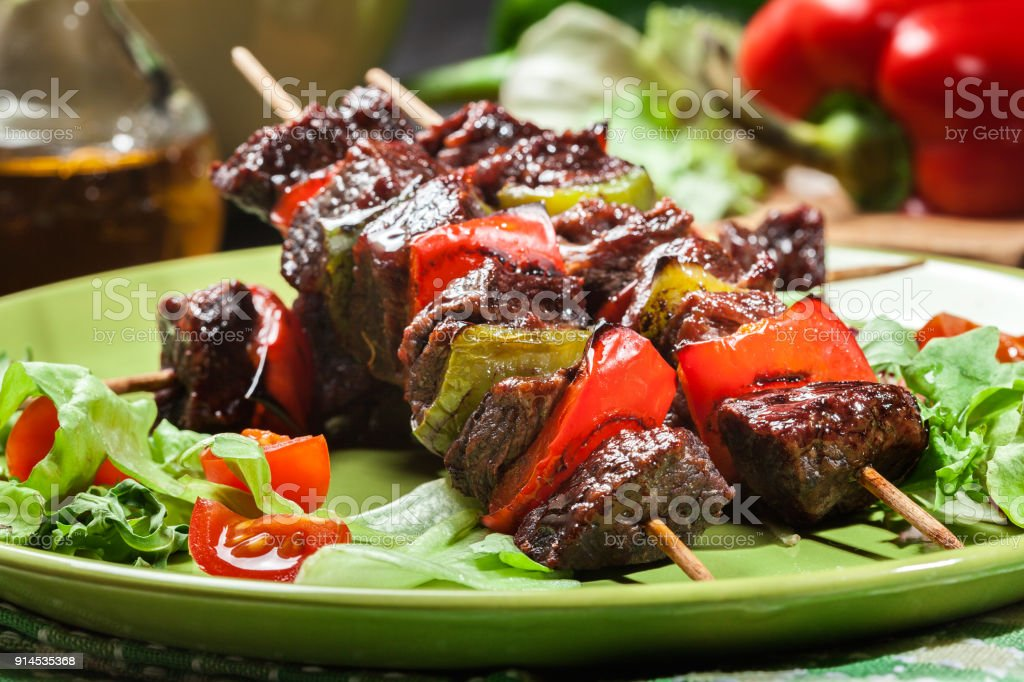 Grilled beef meat and vegetable kebabs stock photo