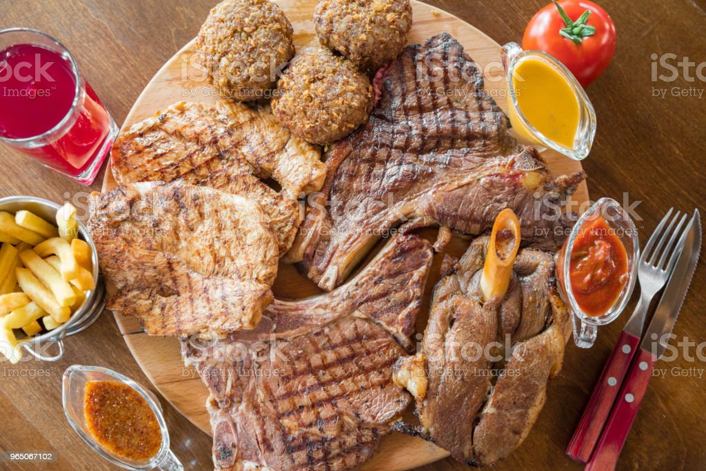 Grilled beef steak and Assorted delicious grilled meat on wooden board zbiór zdjęć royalty-free