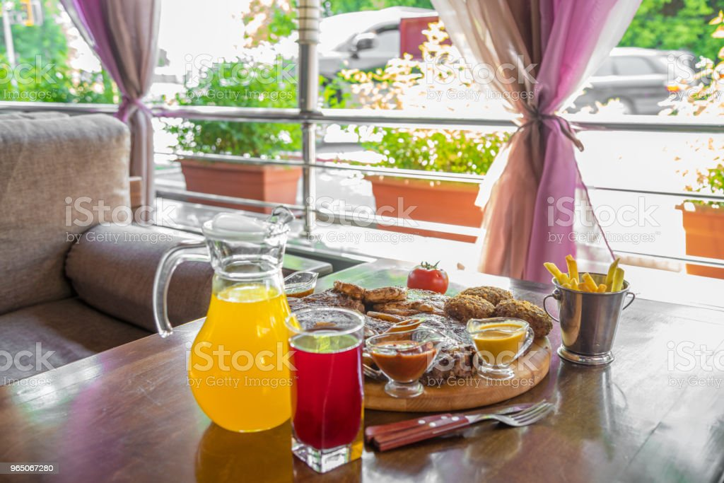 Grilled beef steak and Assorted delicious grilled meat with and cool drinks on the table of the summer veranda zbiór zdjęć royalty-free