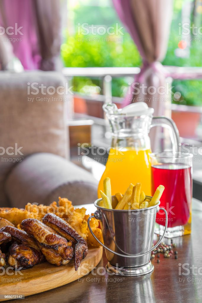 Grilled beef steak and Assorted delicious grilled meat with french fries and cool drinks on the table of the summer veranda zbiór zdjęć royalty-free