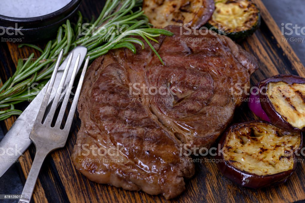 Grilled beef steak black angus and rosemary stock photo