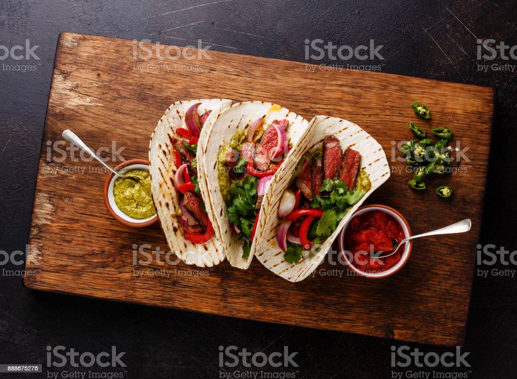 Grilled Beef steak Fajitas taco tortillas with salsa stock photo