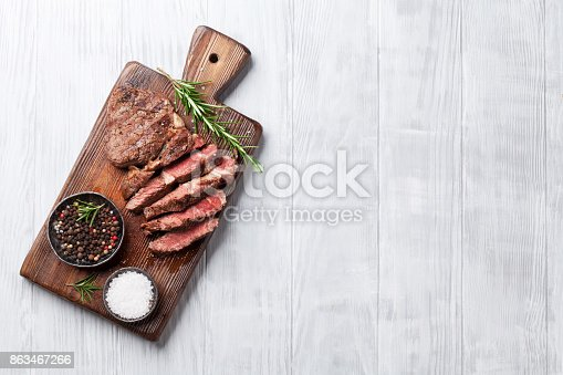 istock Grilled beef steak with spices on cutting board 863467266