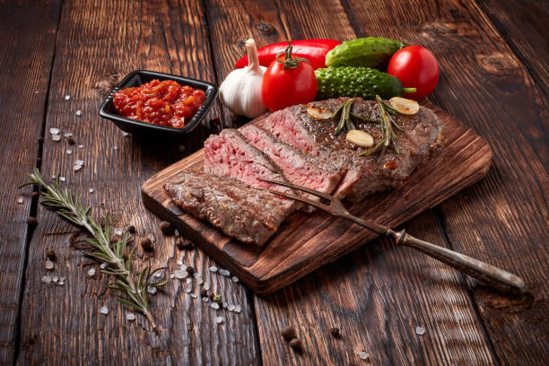 Grilled beef steak with spices stock photo