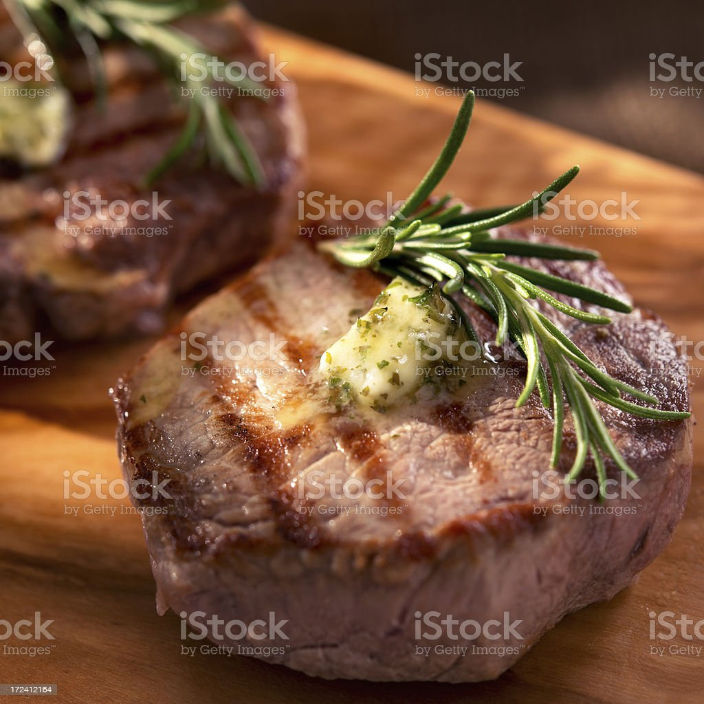 Grilled beef with rosemary and melting butter royalty-free stock photo