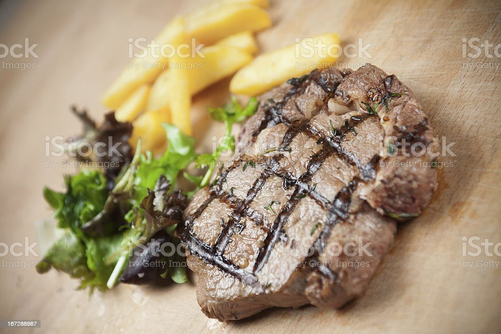Grilled beefsteak with french fries royalty-free stock photo
