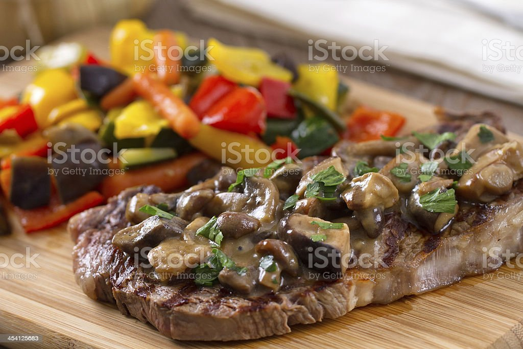 Grilled beefsteak with mushrooms and mixed vegetables. royalty-free stock photo