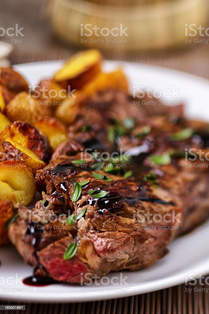 Grilled beefsteak with potateos royalty-free stock photo