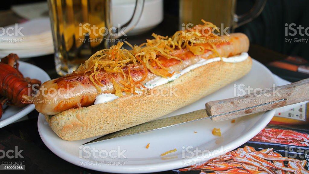 Grilled big hot dog, dark background stock photo