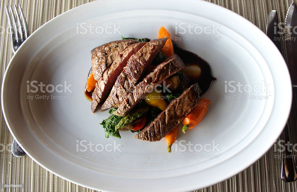 Grilled Bison Red Meat with Roasted Root Vegetables and Glaze stock photo