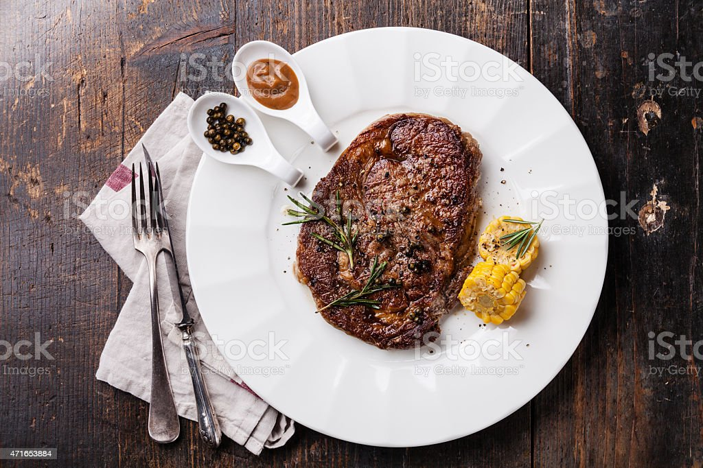 Grilled Black Angus Steak Ribeye and Pepper sauce stock photo