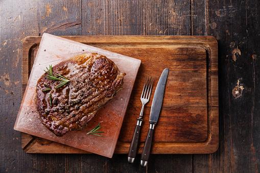 istock Grilled Black Angus Steak Ribeye on Himalayan pink salt block 471573806