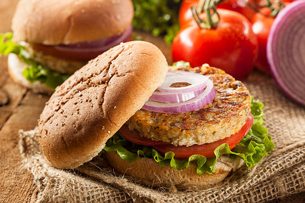 Grilled black bean burger with salad and onions stock photo