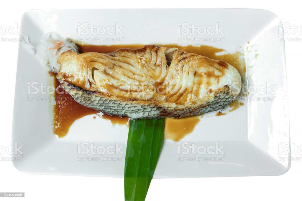 Grilled Black Cod with sweet soy sauce on white plate isolate on white background stock photo