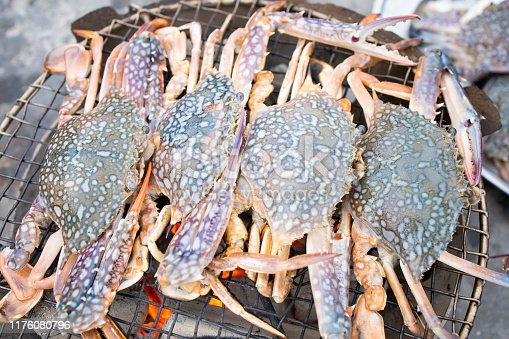 Grilled blue crabs on charcoal
