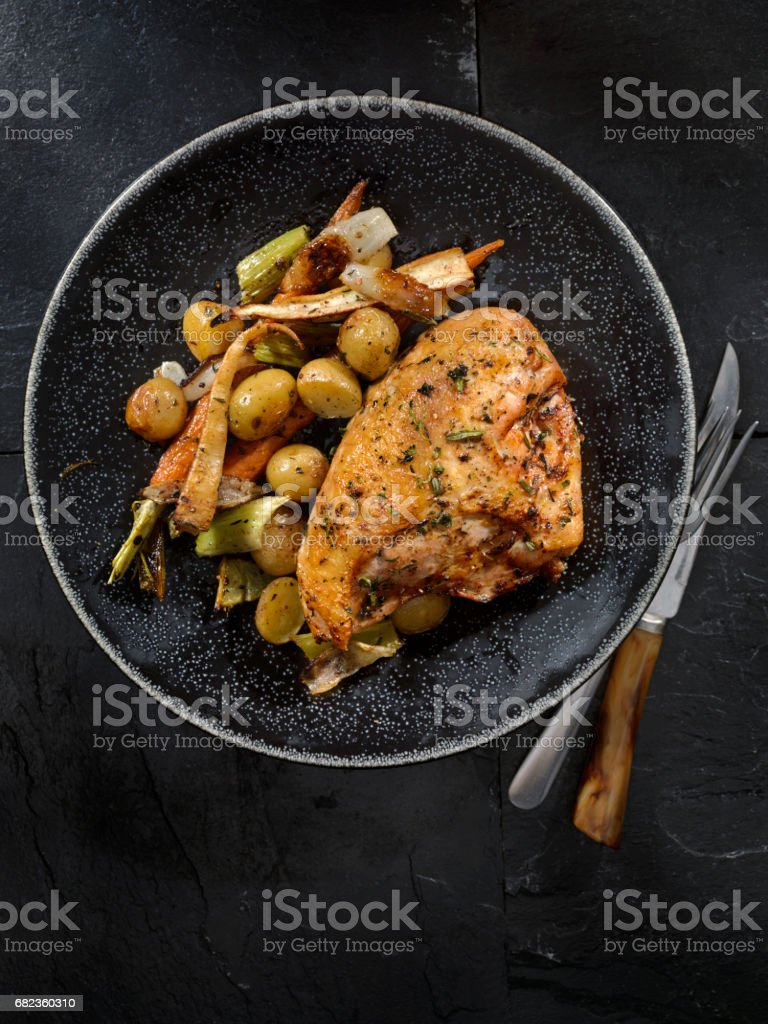 Grilled Bone in Chicken Breasts With Vegetables stock photo