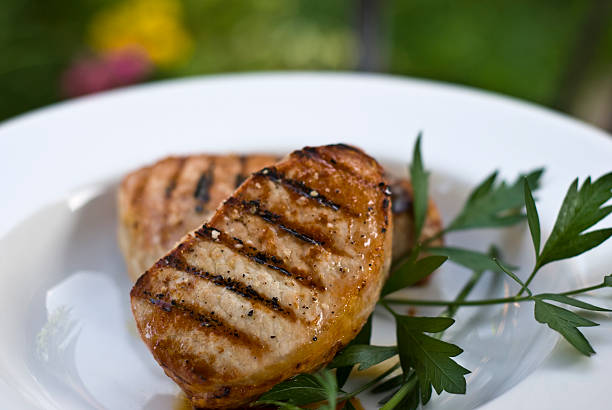 Grilled Boneless Pork Chops summer grilled pork chops pork stock pictures, royalty-free photos & images