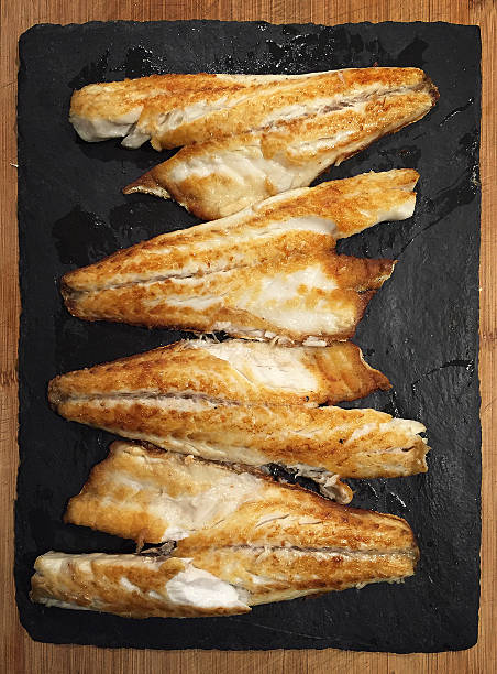 Grilled branzino european seabass stock photo