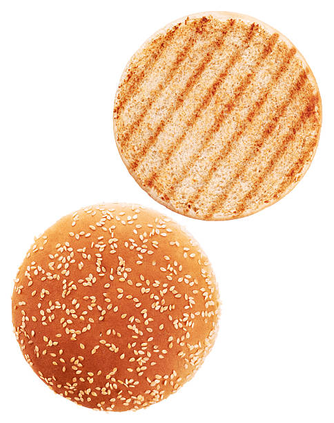 Grilled burger bun isolated on white background. Grilled burger bun isolated on white background. Close up. sweet bun stock pictures, royalty-free photos & images
