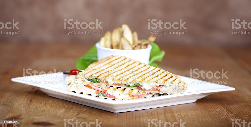 Grilled caprese sandwich with fried potatoes stock photo