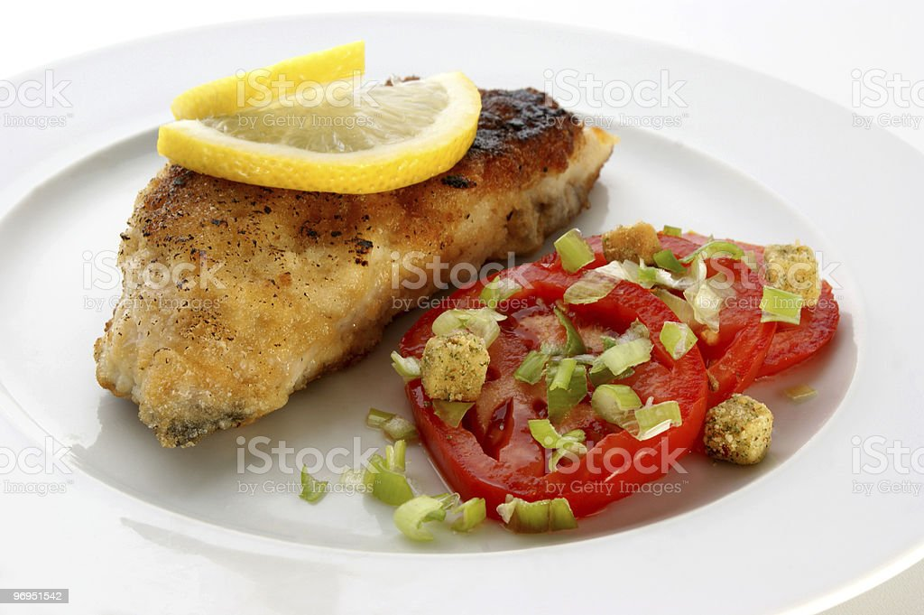 grilled carp fillet with organic vegetable on a plate royalty-free stock photo