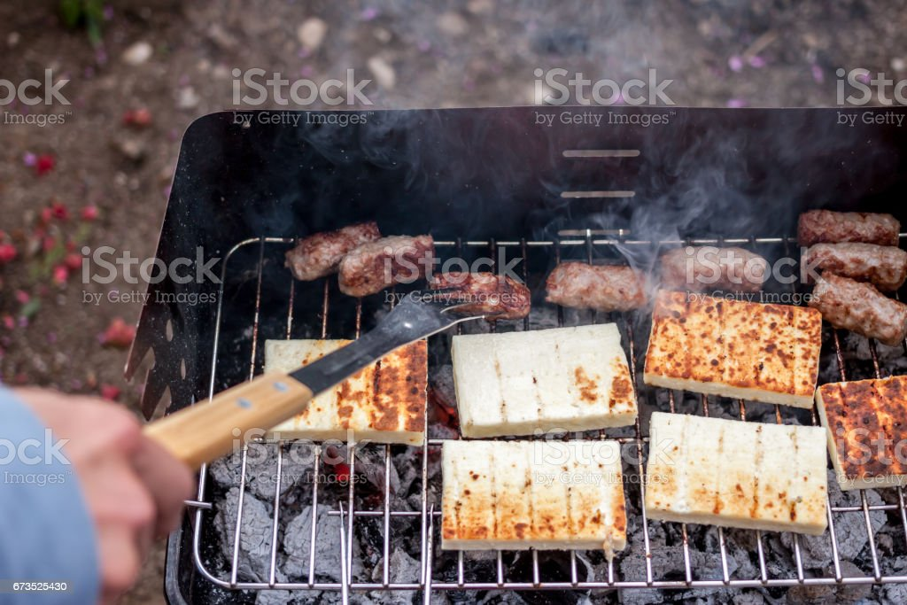 grilled cevapcici and cheese balkan cuisine stock photo