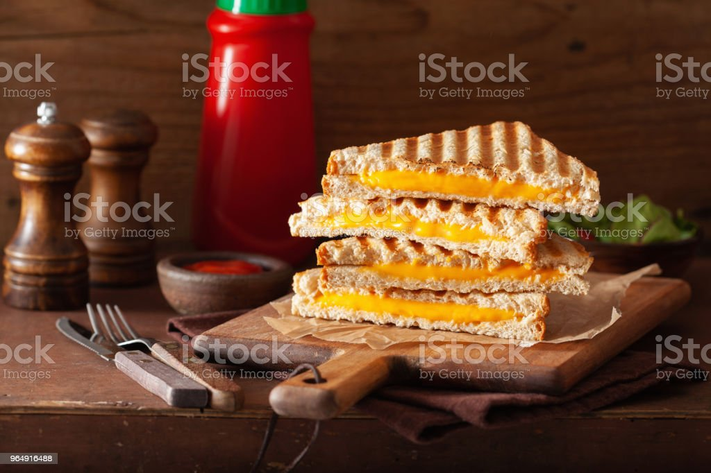 grilled cheese sandwich on rustic brown background royalty-free stock photo