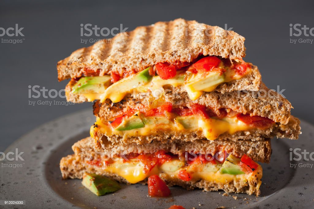 grilled cheese sandwich with avocado and tomato stock photo