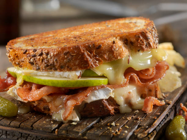 Grilled Cheese Sandwich with Bacon, Brie and Pear stock photo