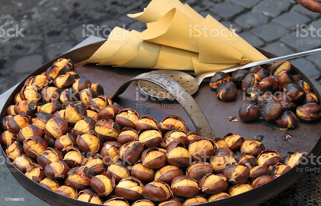 Grilled chestnuts stock photo