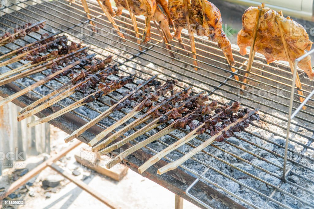 Grilled chicken and grilled liver on the grill. stock photo