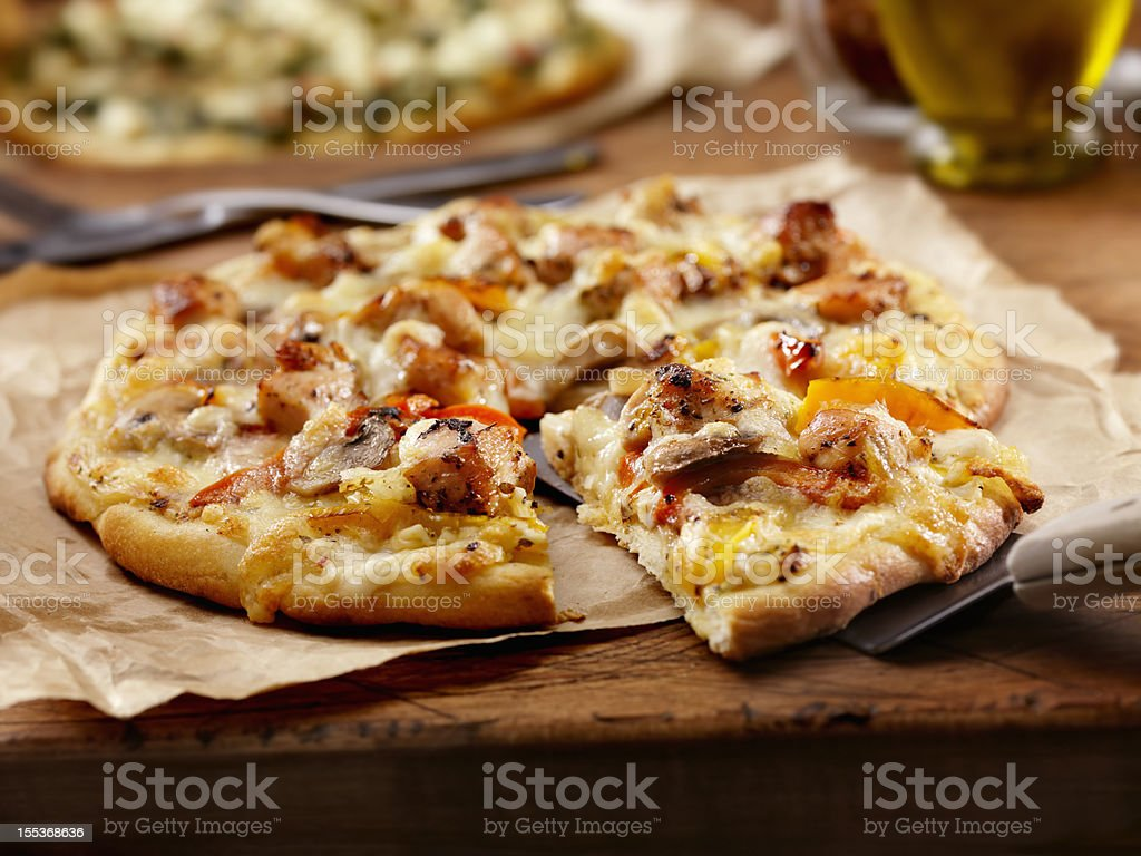 Grilled Chicken and Roasted Pepper Pizza royalty-free stock photo