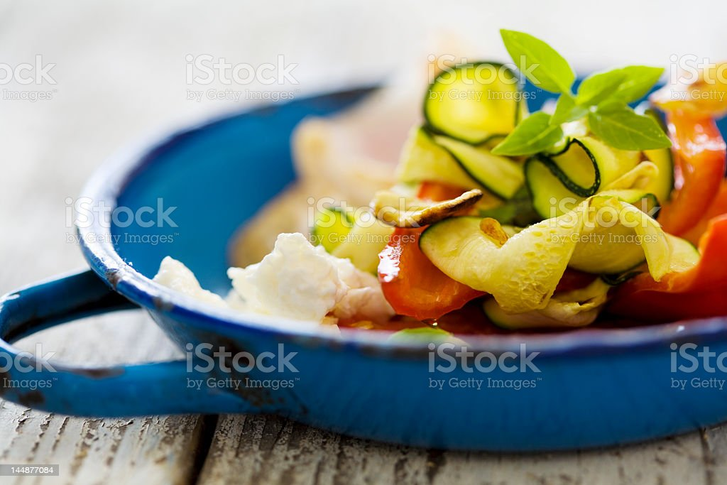 Grilled chicken and salad in a blue bowl royalty-free stock photo