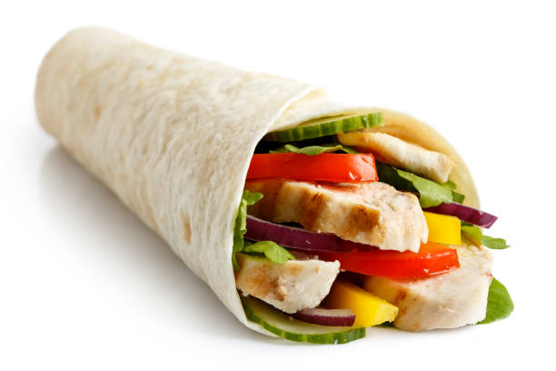 grilled chicken and salad tortilla wrap isolated on white. - tortilla stock photos and pictures