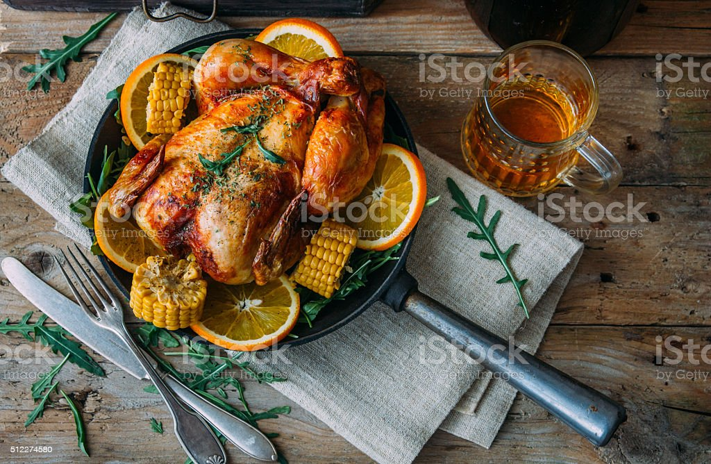 Grilled chicken and various vegetables on wooden plate stock photo